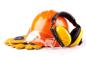 Orange hard hat earphones goggles and gloves on a white background